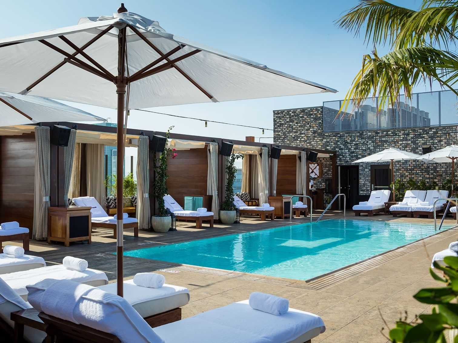 Rooftop pool with Cabanas & sunbeds at Dream Hollywood LA