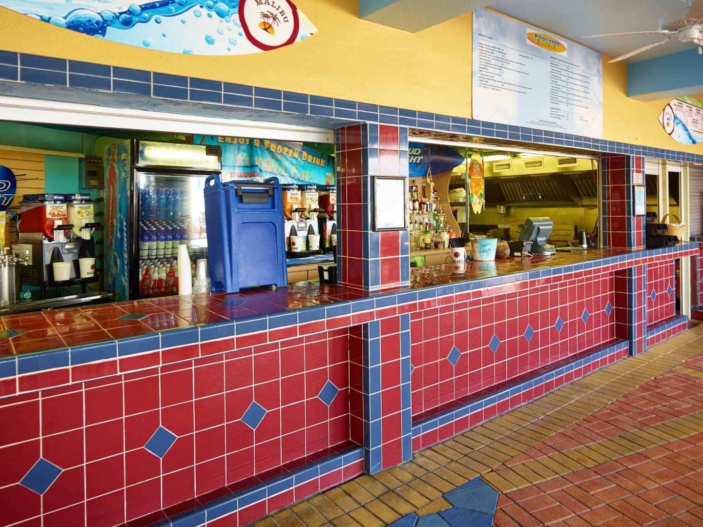 red and blue tiled bar with liquor and refrigerator