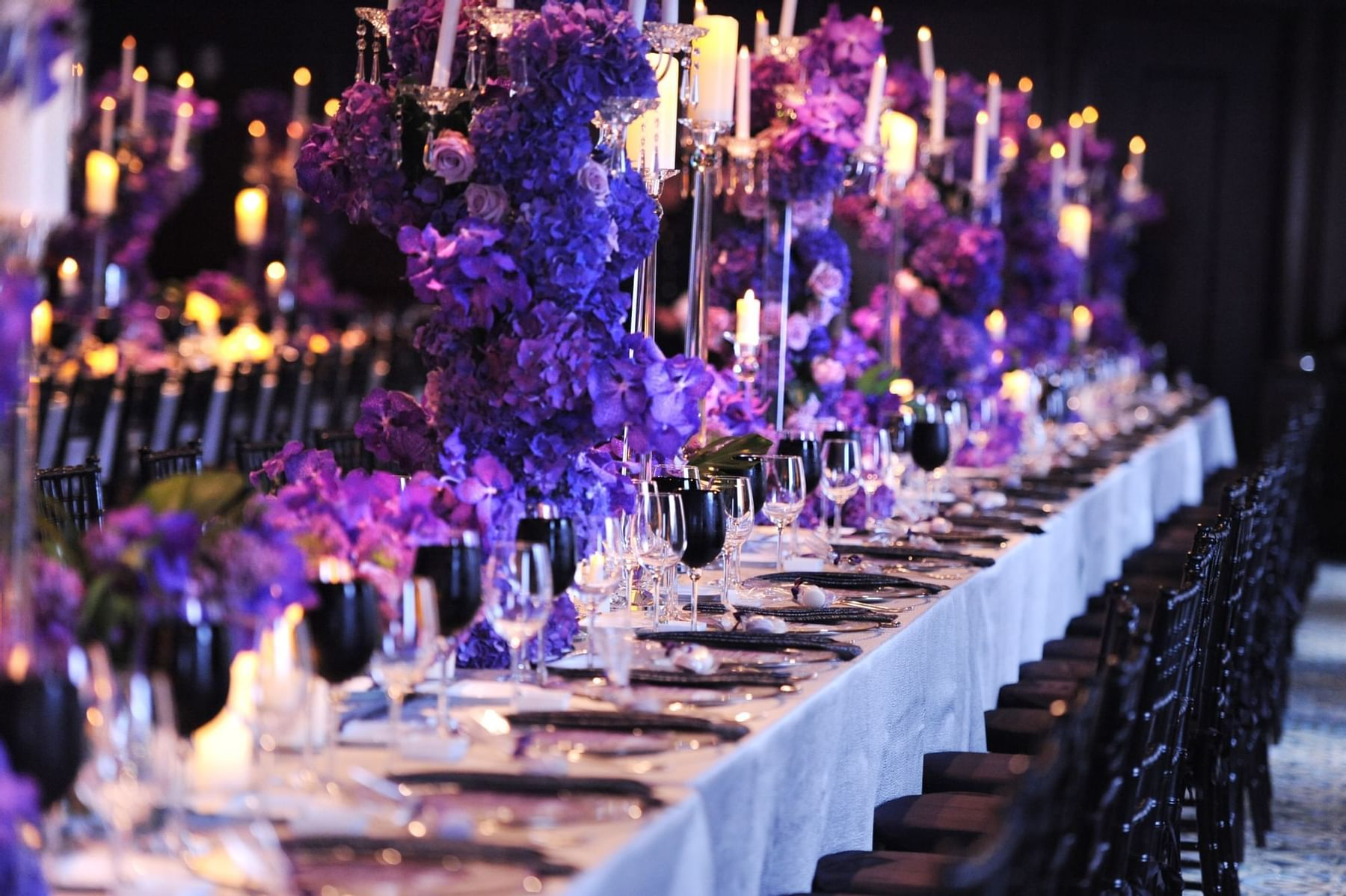 Long conference table set for fancy dining