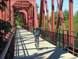 a person riding a bike on a bridge