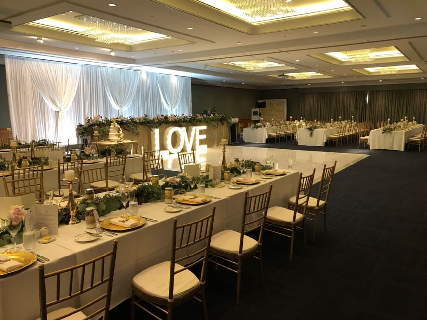 A view of the decorated wedding reception at the Duxton Hotel