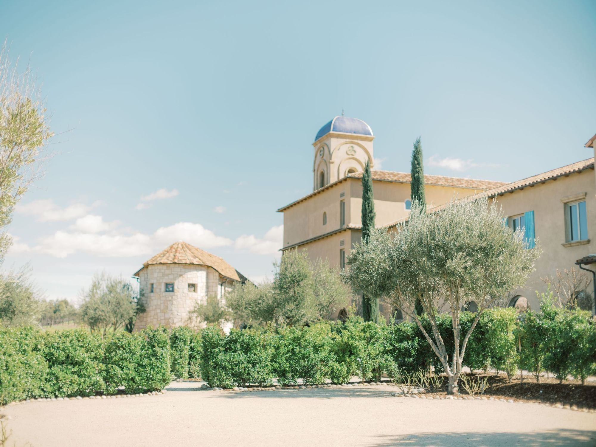 Looking through the landscape of Allegretto Resort at the Abbey