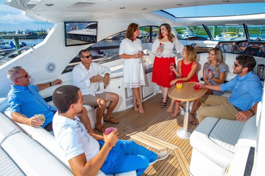 group having drinks on yacht deck