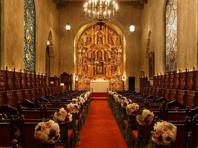 aisle to altar lined with flowers