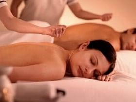 A couple getting a Massage in the spa at Ana Hotels
