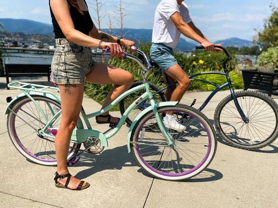 A couple riding bicycles near Manteo Resort