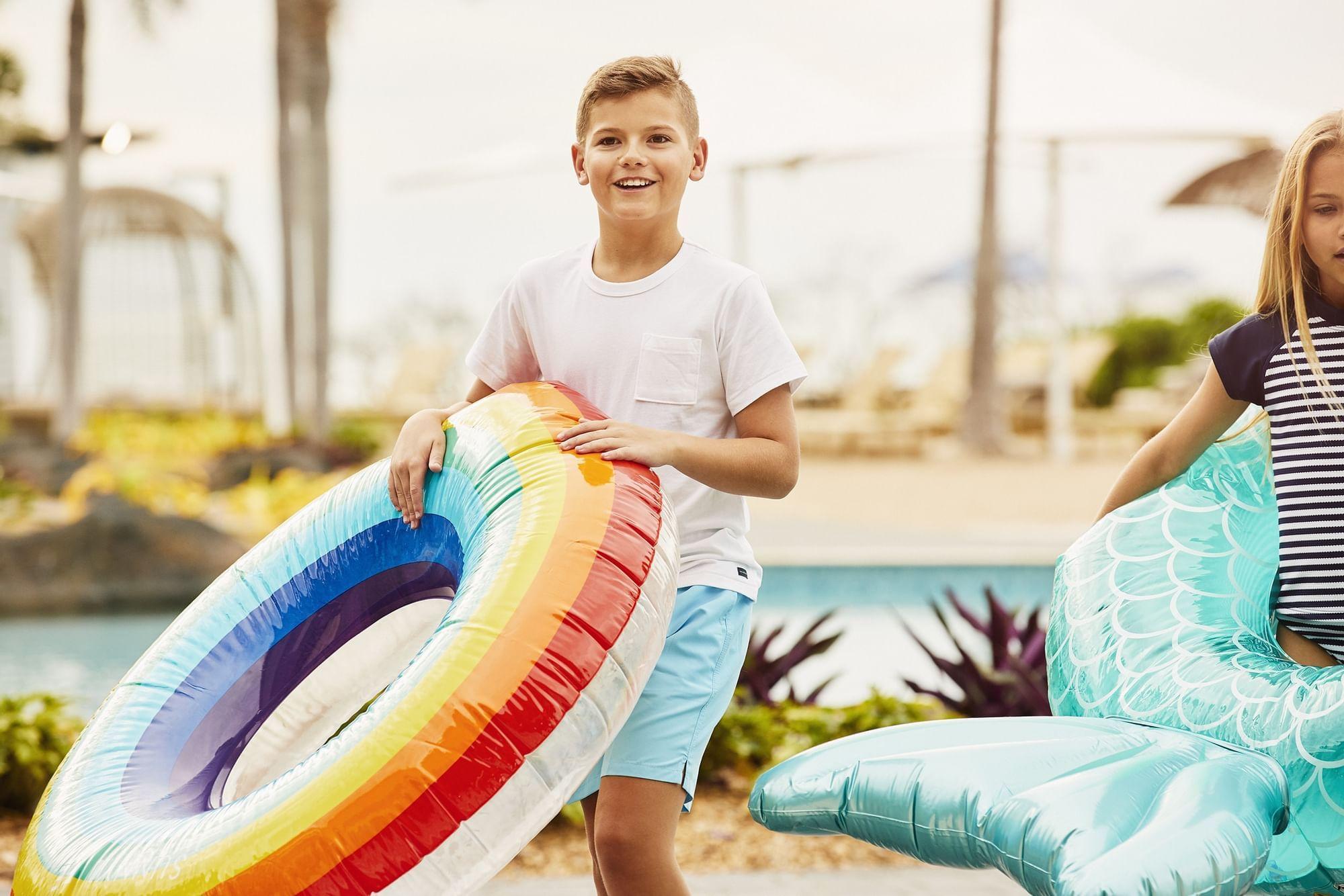 Kids having fun in pool at Daydream Island Resort
