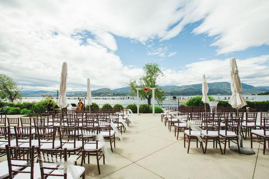 Patio with wedding ceremony arrangements at Manteo Resort