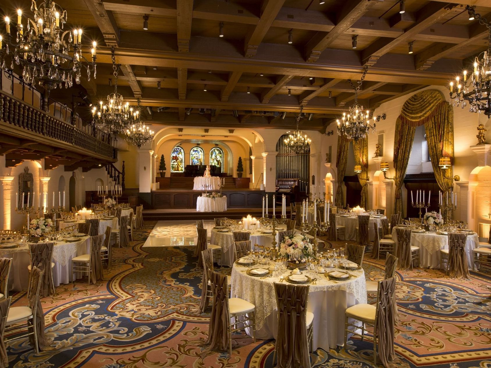 formal ballroom with dining tables and chandeliers