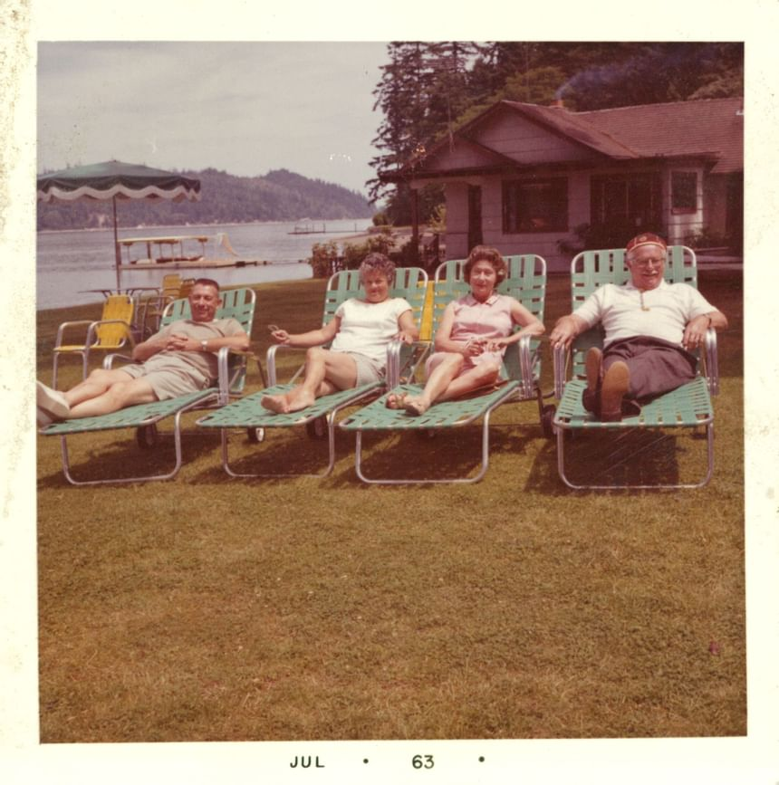 An old picture of a group of people sunbathing at Alderbrook