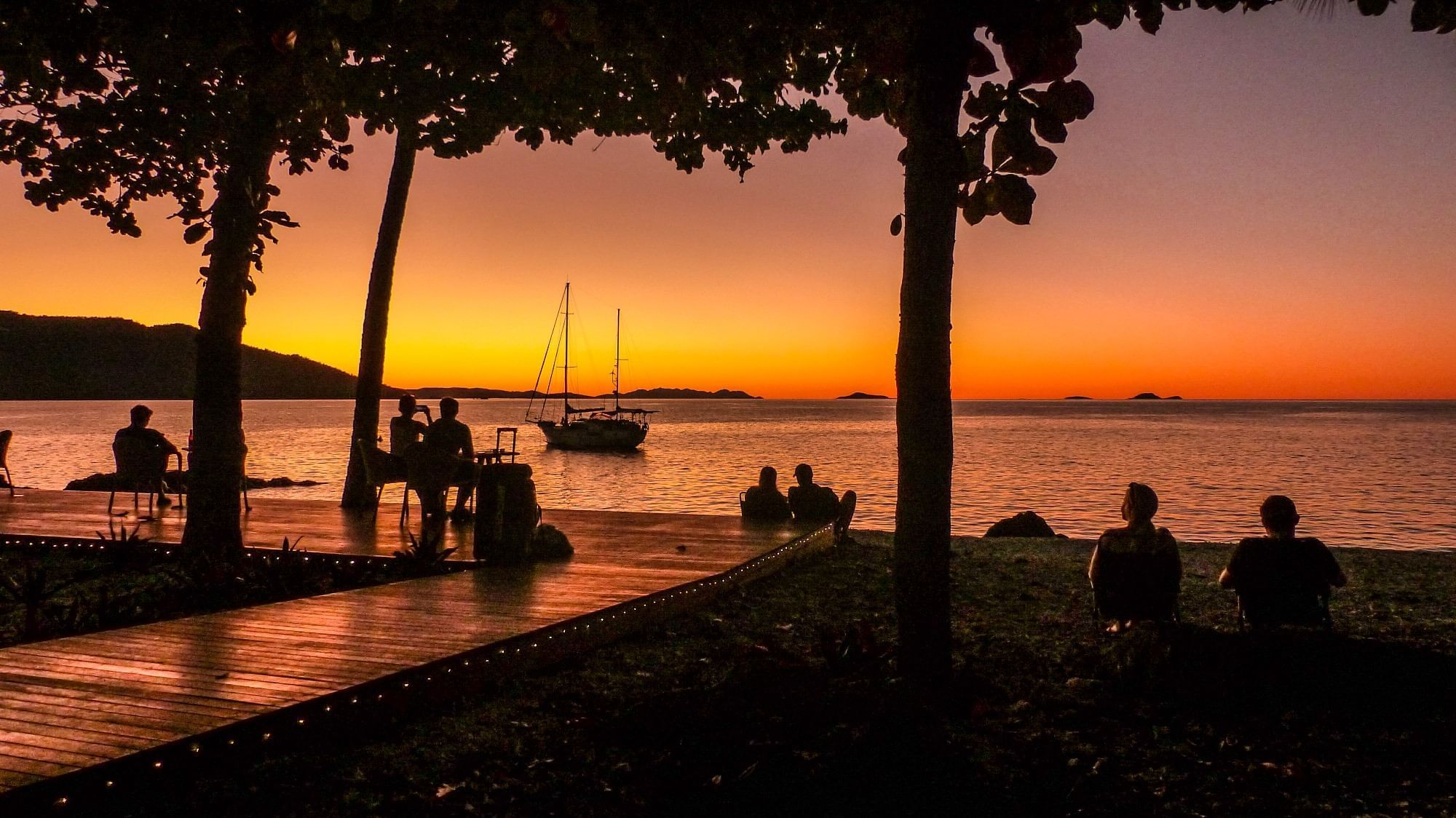 View of beach and ocean at sunset at Daydream Island Resort