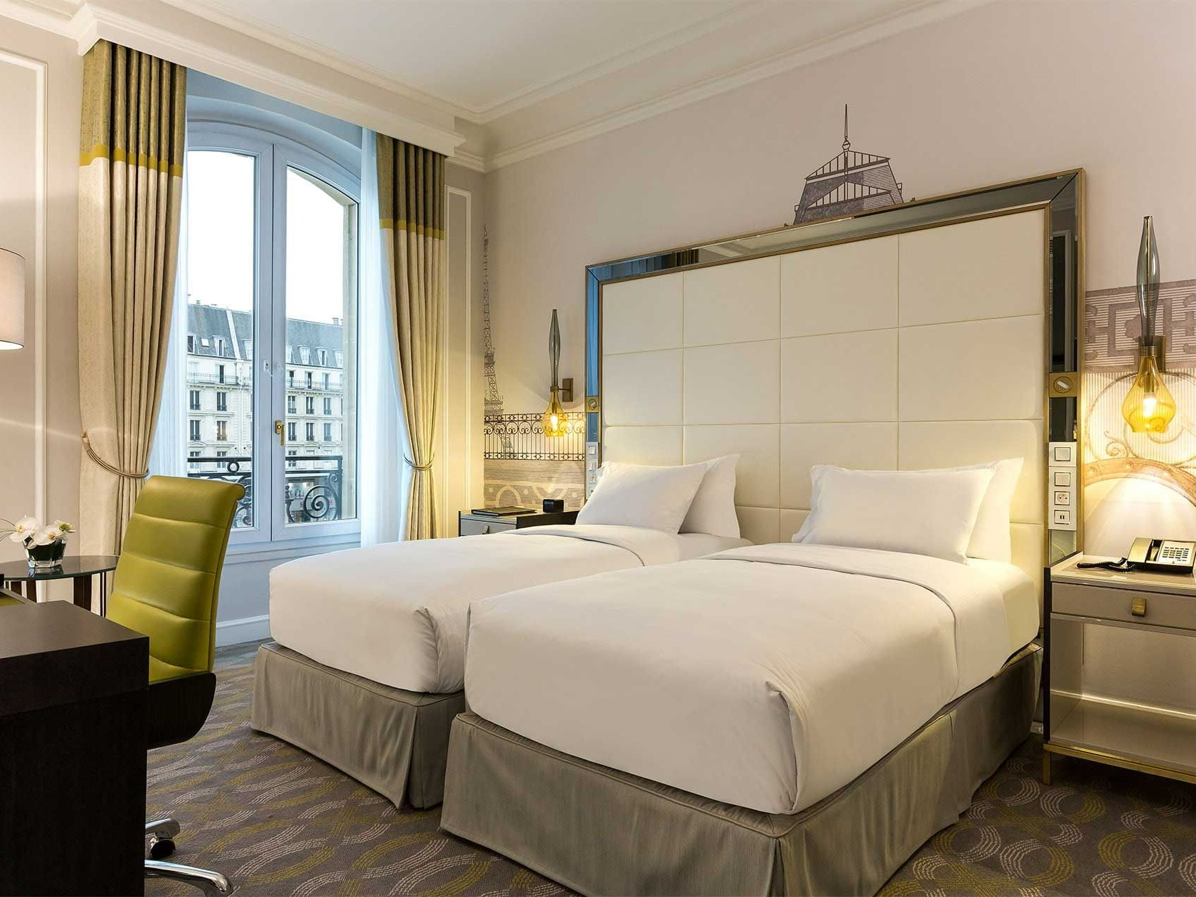 Bed & furniture in Twin Deluxe Room at Hilton Paris Opera Hotel