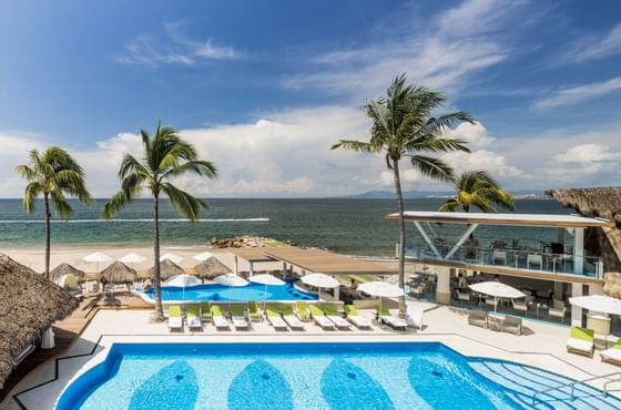 a hotel pool right on the beach