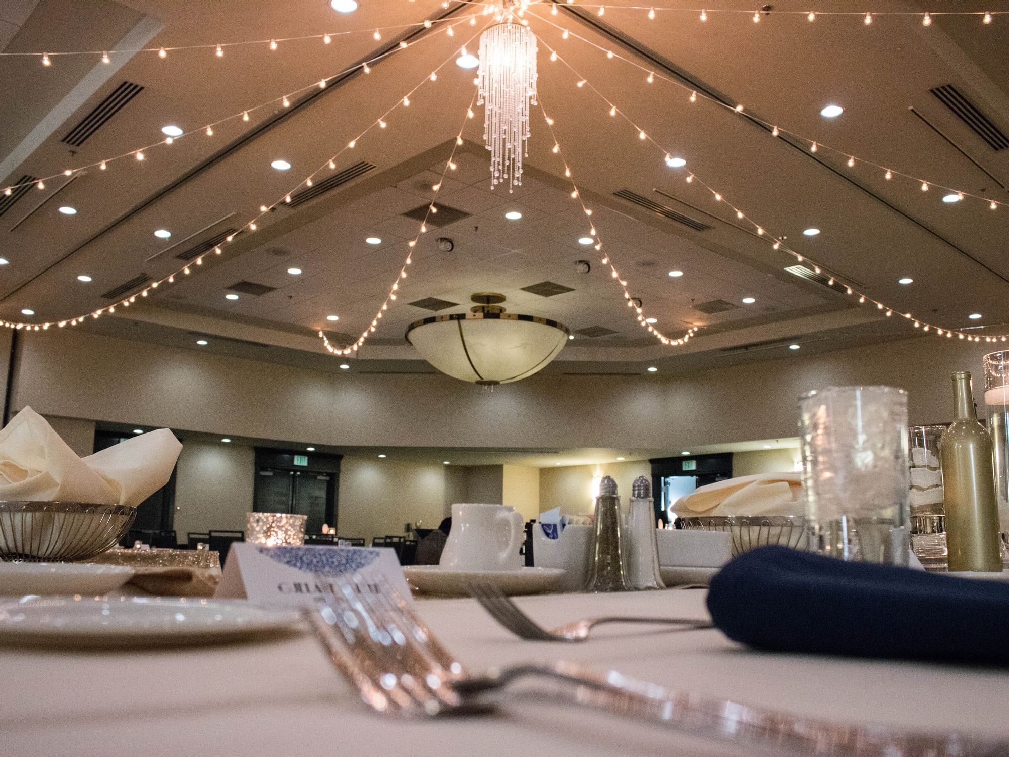 silverware on tables in a large room