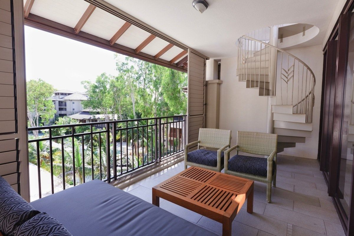 Balcony with a out door stair at Pullman Palm Cove Sea Temple