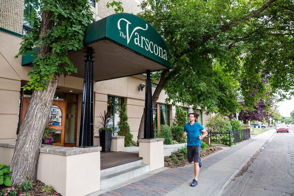 Man walking past the hotel entrance at Varscona Hotel on Whyte
