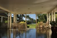 Waimea Plantation Cottages covered patio overlooking the grounds