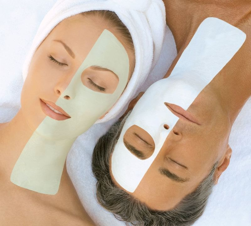 Couple having facial therapy in spa at Daydream Island Resort