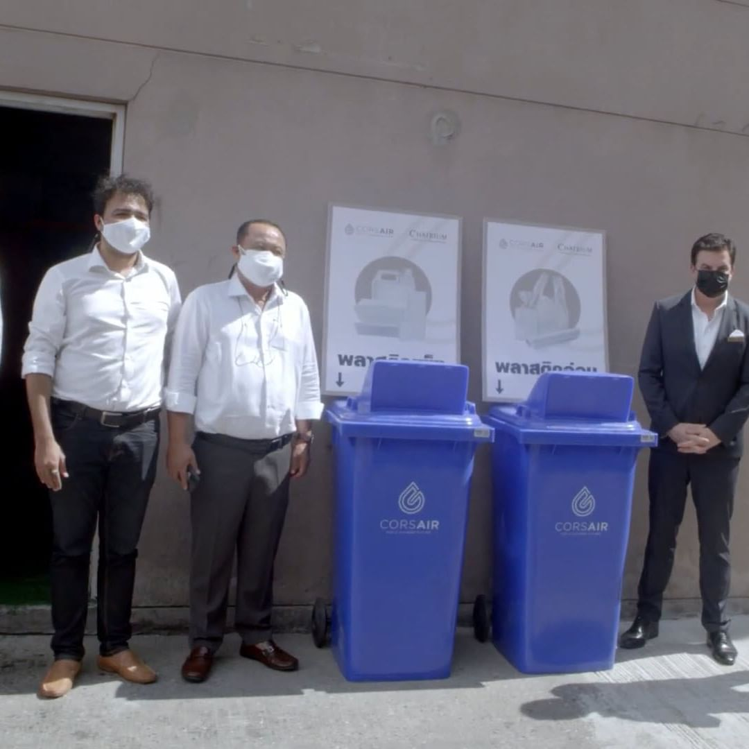people with recycling bins at Chatrium Hotels & Residences