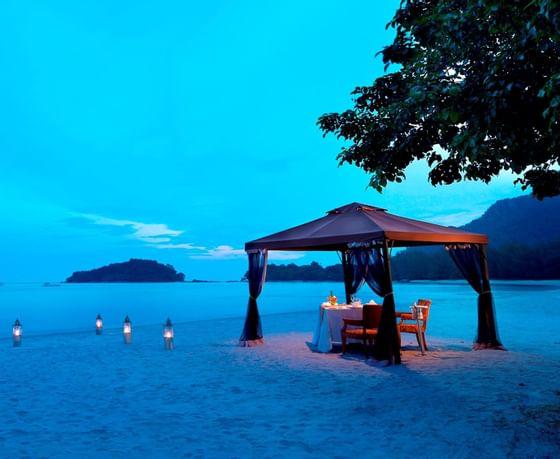 romantic beach dinner set up at The Danna Langkawi