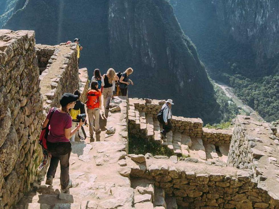 Tourists exploring Machu Picchu Citadel near Hotel Sumaq