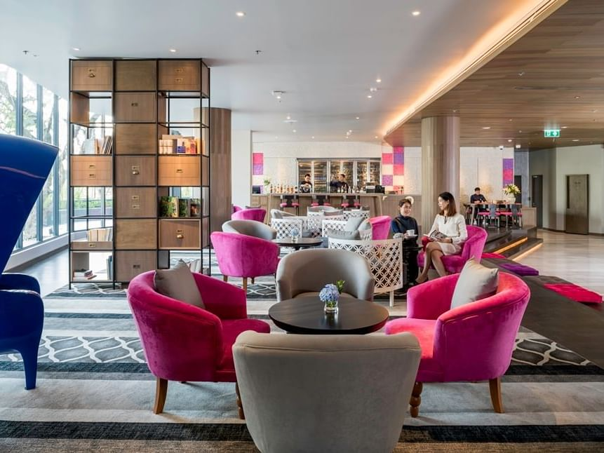 Library with spacious seating area at U Hotels and Resorts