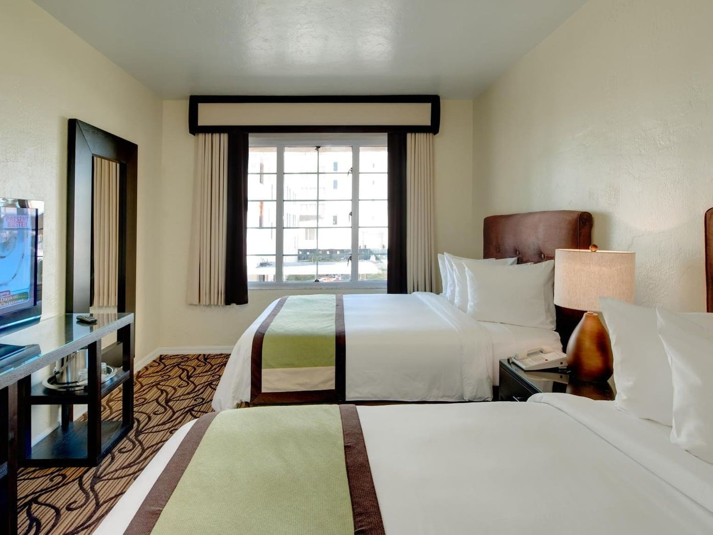 A view of Deluxe Double room with two double beds at Essex House by Clevelander
