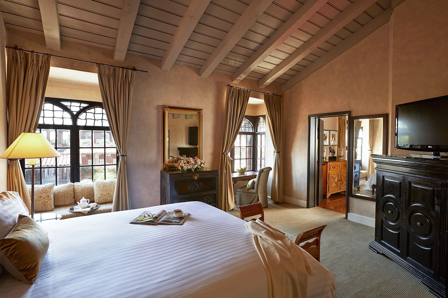 room at Mission Inn with bed, dresser and television