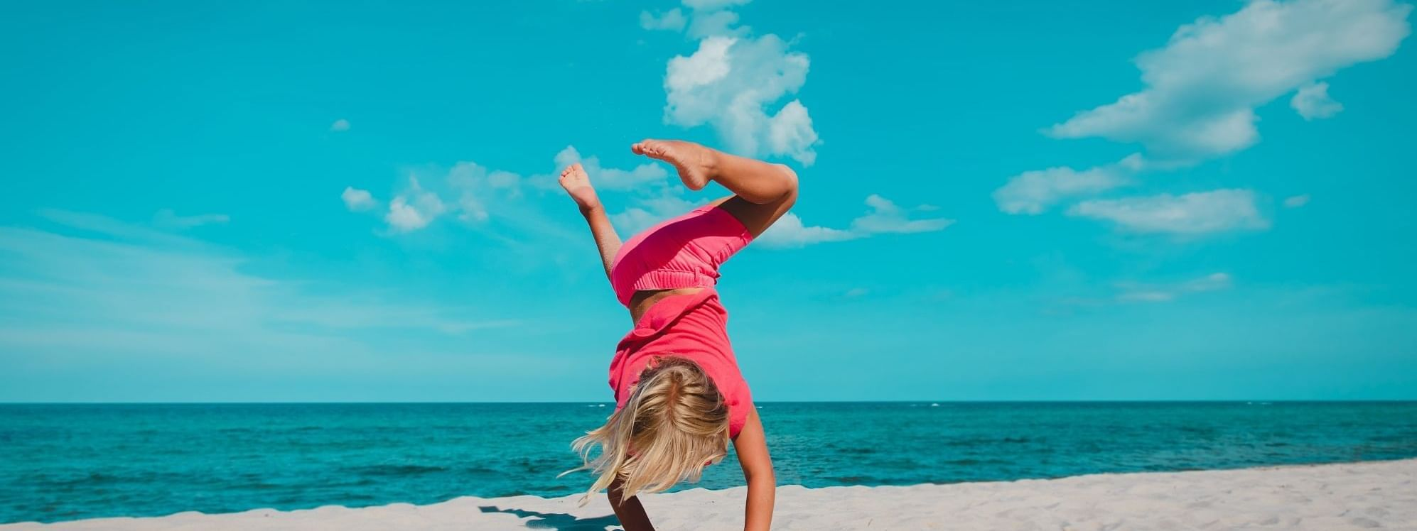 Kid playing on beach at Daydream Island Resort