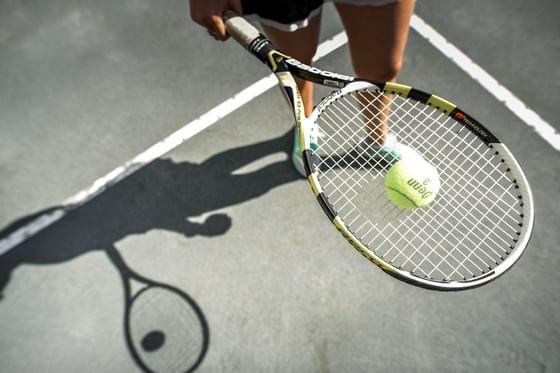 Tennis racket and a tennis ball at Topnotch Stowe Resort