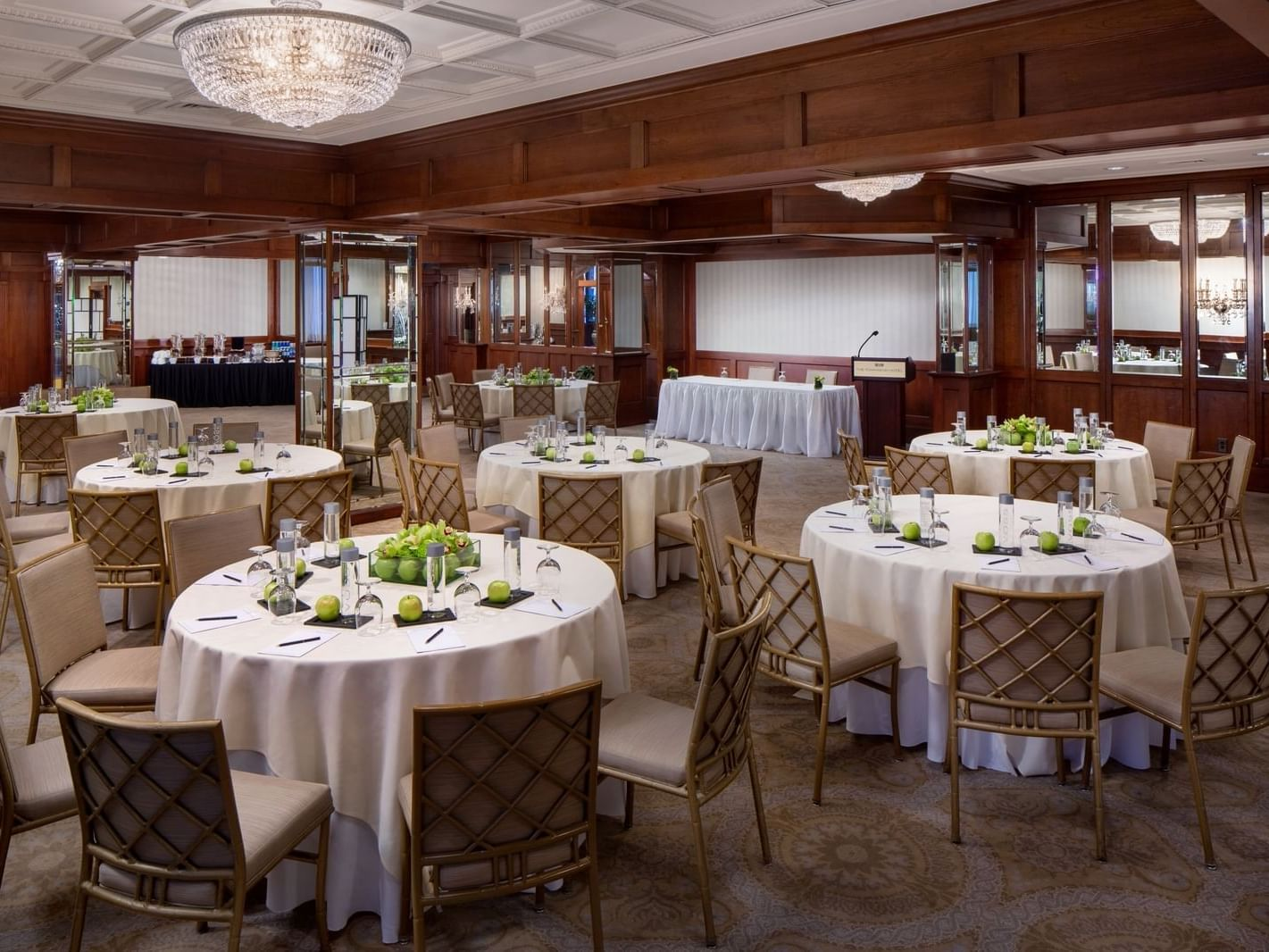 multiple tables in a spacious event room