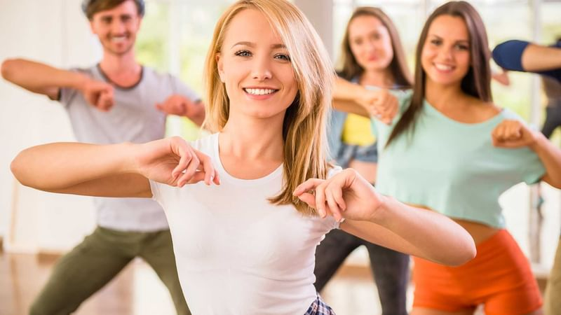 Guests attending dancing classes at The Reef Resorts