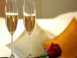 Champagne glasses and rose