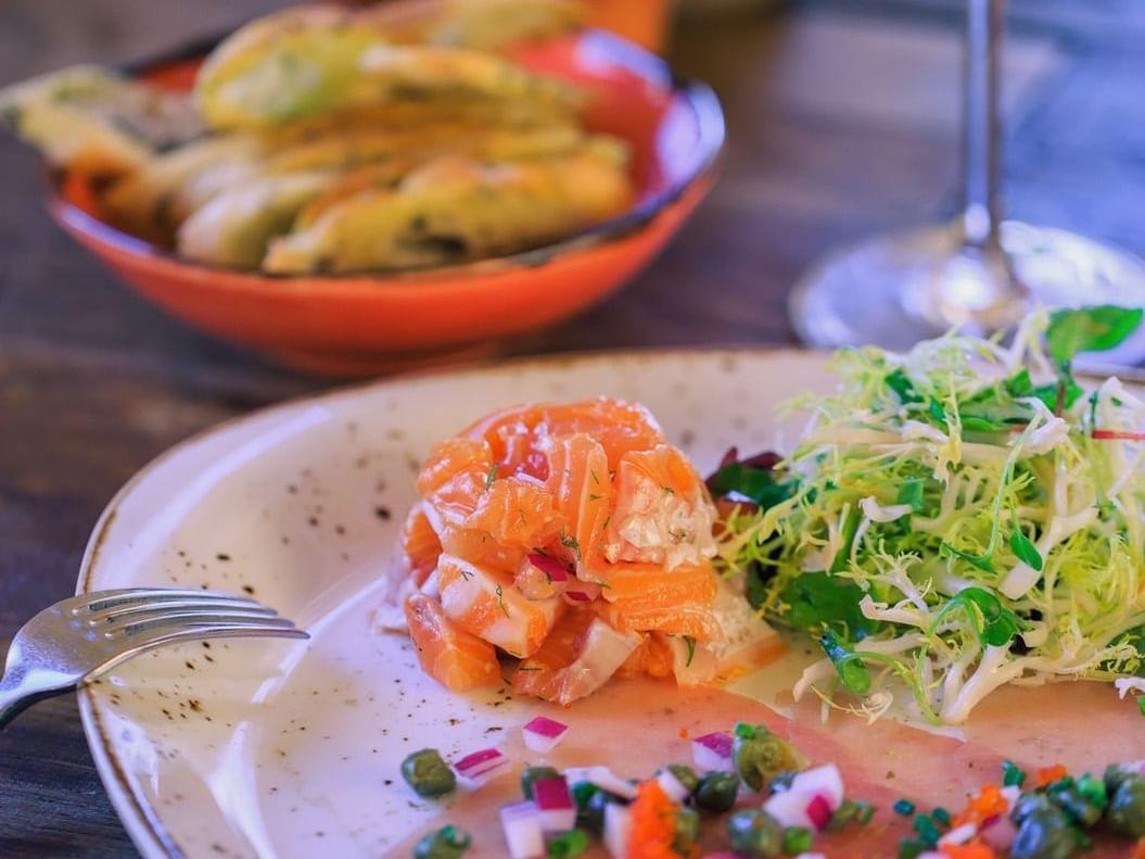Tuna Carpaccio plate and white wine glass