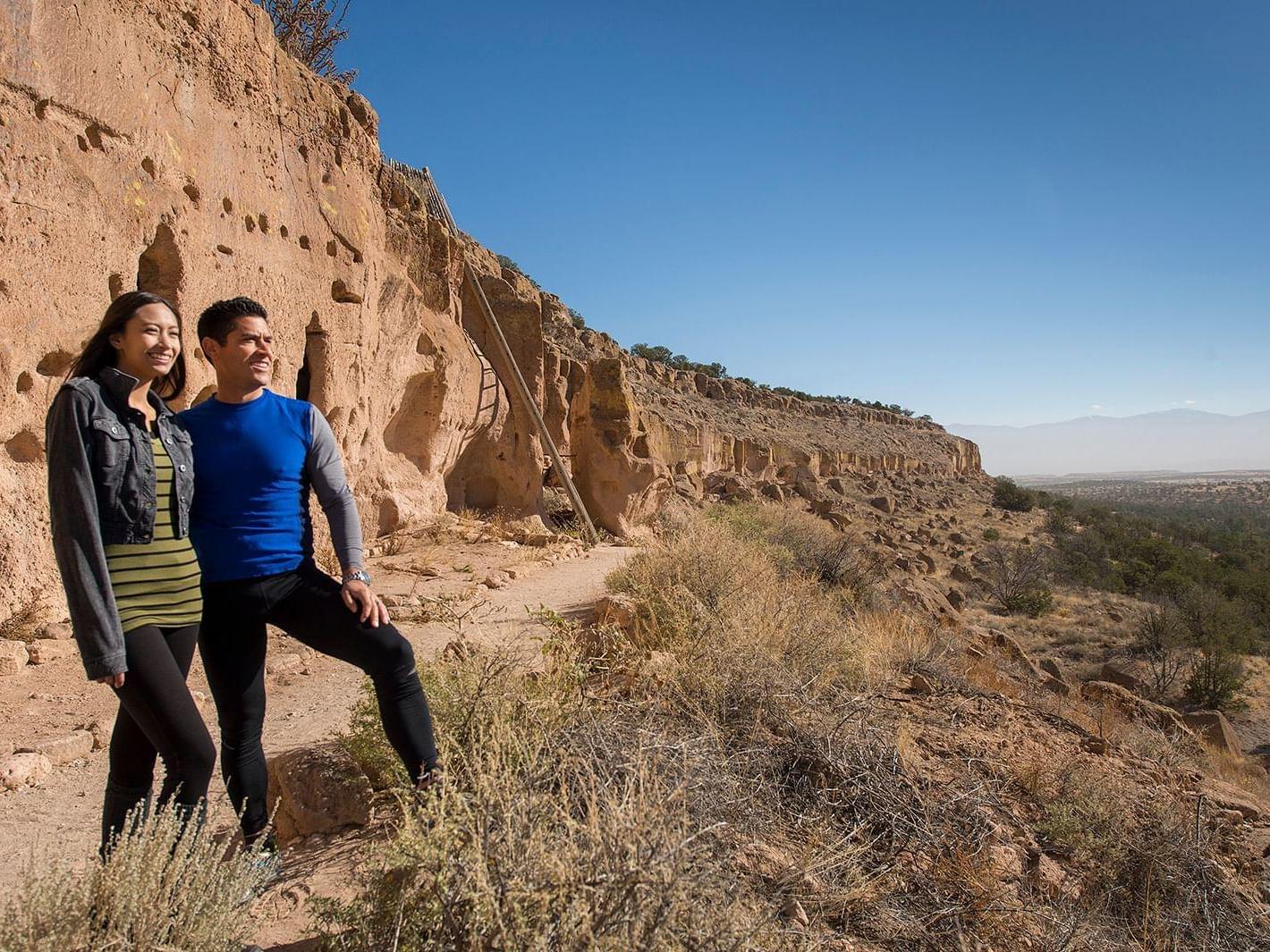 Couple enjoying in Puye cliff dwellings near Santa Claran Hotel Casino