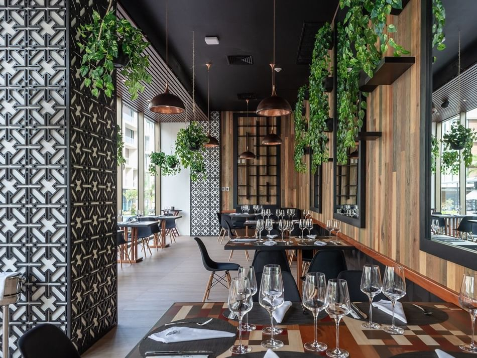 Arranged dining tables in Asiatico Restaurant at The Reef 28