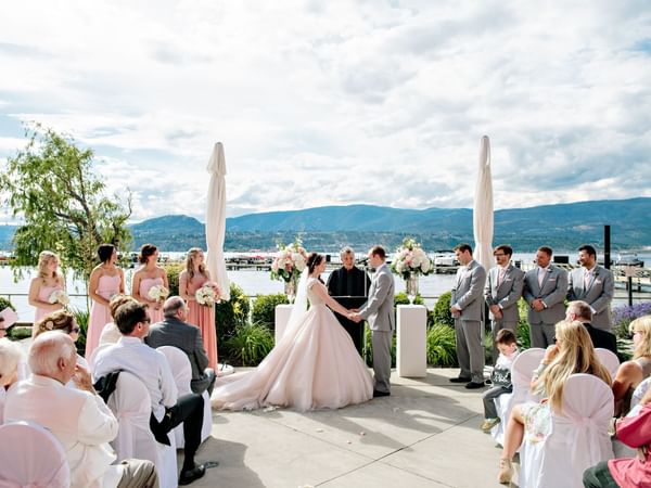 A wedding ceremony at the Patio in Manteo Resort