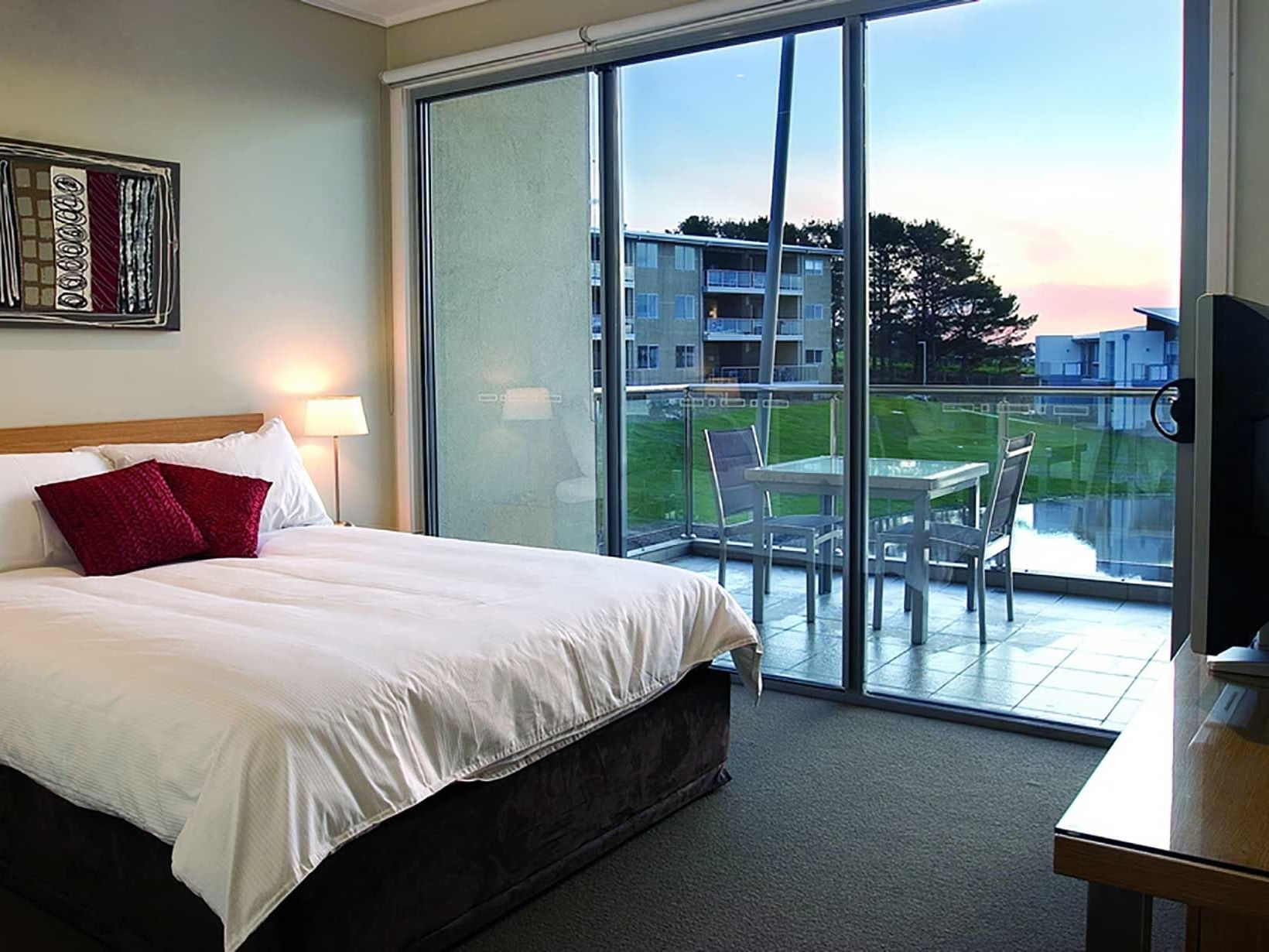 Resort Rooms bedroom with kingbed & a TV at Silverwater Resort