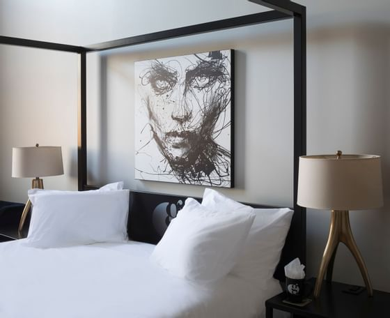 bed with intense artwork