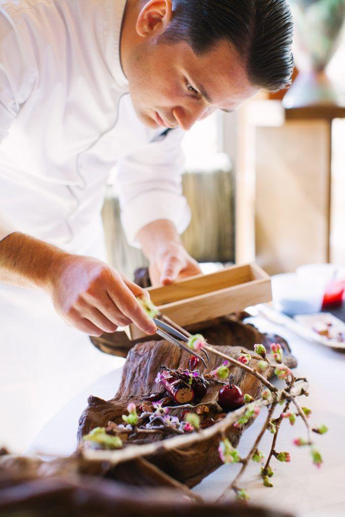 Chef preparing a meat dish
