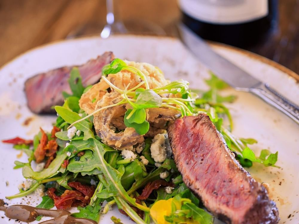 Steak salad and a glass of red wine