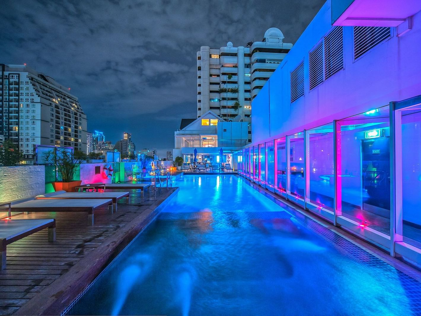 Roof top swimming pool view with pool chairs at Dream Bangkok