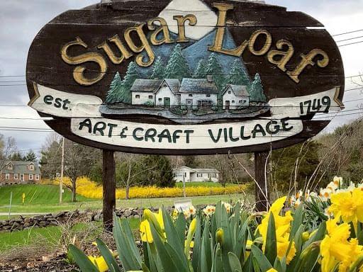 Logo for Sugar Loaf Arts and Craft Village
