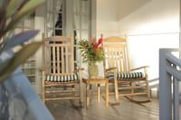 Rocking Chairs on a patio at Waimea Plantation Cottages