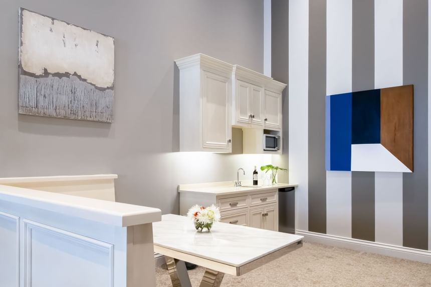 Presidential suite kitchenette area with sink and banquette seat