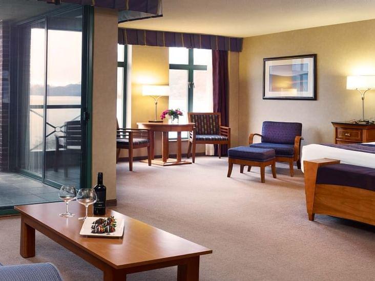 living room area with window overlooking ocean