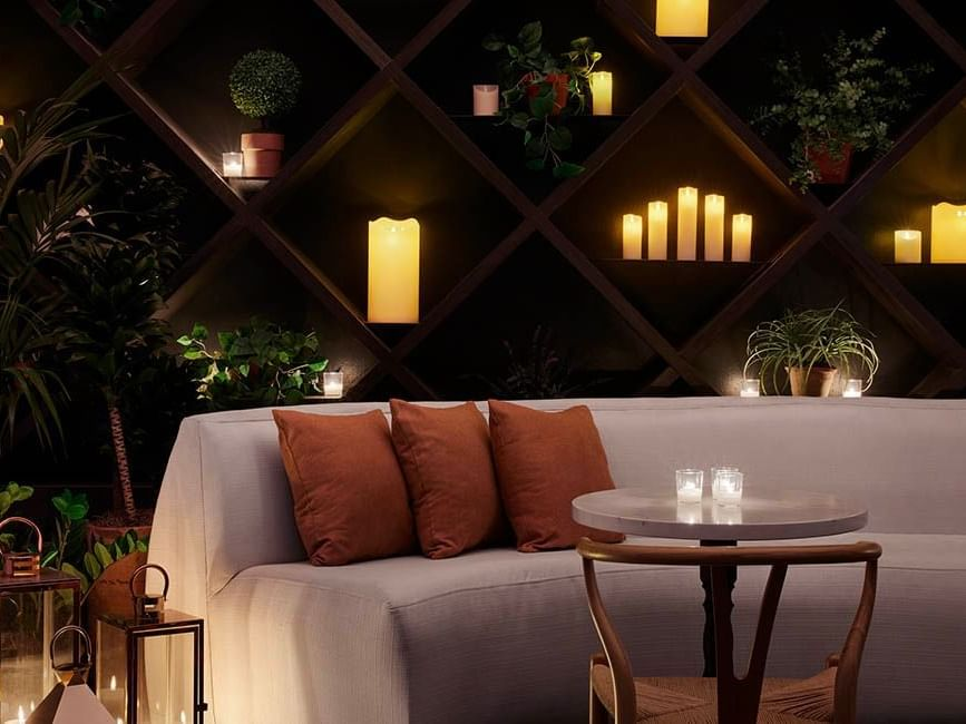 cozy seats at rooftop bar
