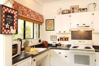 Kitchen in a cottage at Waimea Plantation Cottages