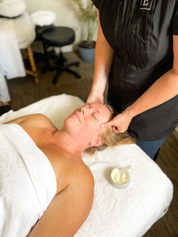 A woman receiving a massage at the Spa in Manteo Resort