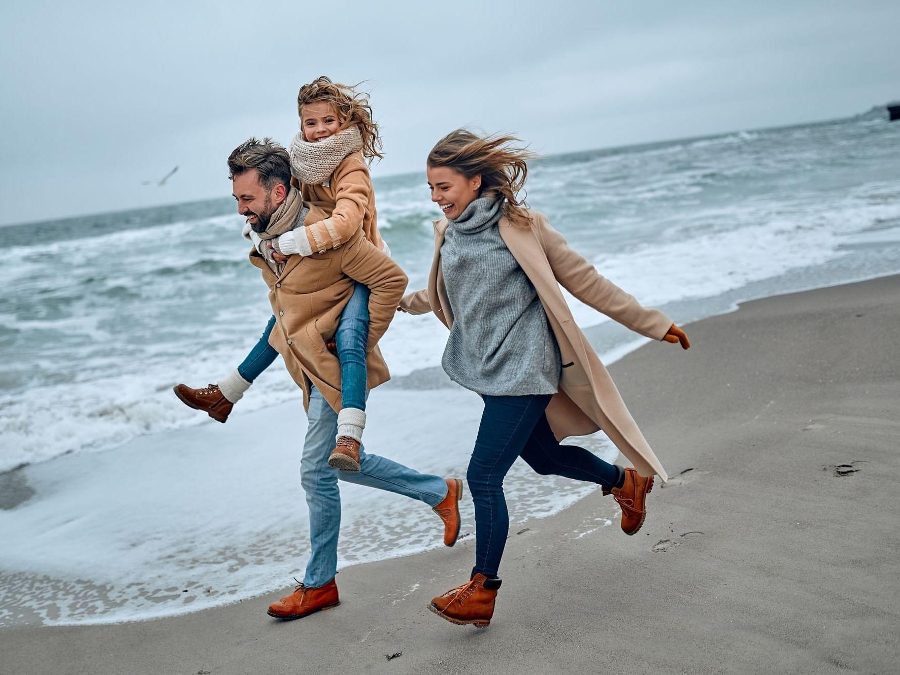 Family having fun on beach at Daydream Island Resort